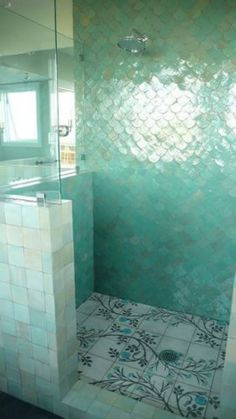 Aquamarine wall tiles. Mosaic on the floor. LOVE!