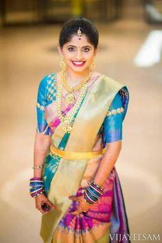 South Indian bride. Kanchipuram silk sari. Temple jewelry. Braid with fresh flowers. Telugu,Hindu bride