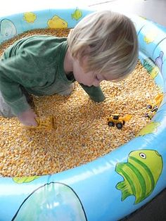 Fill a plastic baby pool with corn for sensory fun! You will need about two 50 lb bags of corn (found at agriculture, farm and tractor stores).