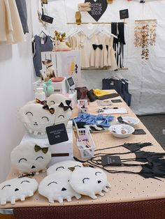 I like how easy  and portable the hanging dowels are to display items that need to be hung. And the skull pillows are cute.   Booth display @ Renegade Craft Fair by WithLoveXOX, via Flickr