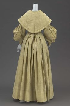 Wedding dress with matching cape (dress) 1839 (b) matching short round shoulder cape; bodice lined with unbleached heavy cotton twill; skirt faced with cream colored cotton, and cape lined with cream colored cotton.