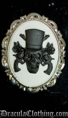 skull and guns cameo brooch