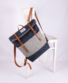 Men's grey backpack made of wool and leather. The rucksack has two large pockets on the front as well as two on the inside, perfect for storing your essentials – a unique product by Breagha via en.DaWanda.com