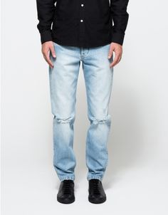 From Soulland, classic washed out jeans in light Vintage Blue wash.  Features classic five pocket styling, button fly with top branded button, fade detail, intentional distress detailing on the knees and hem, belt loops and straight fit with slightly tape