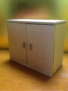 Miniature doll/toy dresser or closet. I love it!