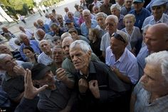 Anger: Elderly people argue with a bank worker as they wait to be allowed into a bank to w...