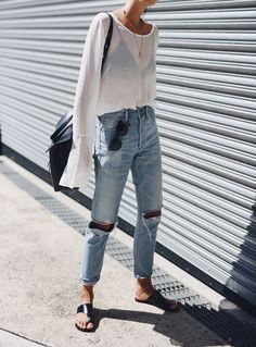 Knee hole distressed denim, gauzy white keyhole blouse, black bralette outfit, black minimalist sandals, black leather bag