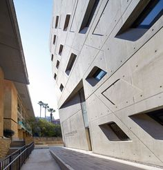 Zaha Hadid has completed a top-heavy university building, which cantilevers out over a public courtyard and a series of elevated pathways.
