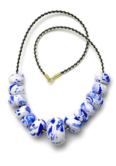 This necklace is the hero of our China Blue range and features marbled hand-formed polymer clay beads in tones of white and ultramarine blue thread...