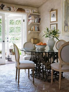 Creative Reuse   Search flea markets and tag sales for antiques that you love, whether it's because of the shape or the design, and turn them into something new. Here, antique moldings are repurposed as ornate shelves around the French doors to maximize storage in the room. An antique iron balustrade is topped with glass to become a fancy yet functional breakfast table.