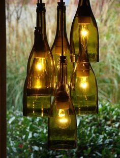 Start saving your wine bottles because I have gathered a collection of 15 amazing DIY Wine Bottle Garden Ideas that you are going to want to make for your own sacred spaces. Empty Wine Bottles, Wine Bottle Art, Lighted Wine Bottles, Bottle Lights, Wine Bottle Crafts, Glass Bottles, Wine Bottle Lighting, Wine Bottle Fence, Wine Bottle Candles