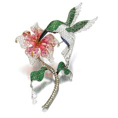 This piece is so so natural! How beautiful these 5 pink color conch Pearls of intense saturation on the flower! A Hummingbird Clip Brooch set with circular-cut Diamonds, Tsavorite Garnets and Sapphires.