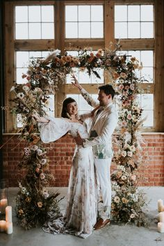 Bride and Groom Celebrating in Front of Dried Flower Wedding Arch Fall Wedding Arches, Wedding Arch Rustic, Boho Wedding, Floral Wedding, Wedding Ceremony, Wedding Flowers, Wedding Dresses, Bohemian Weddings, Ceremony Arch