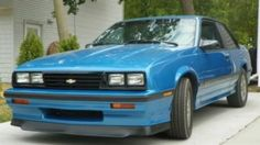 Car #4 - 1987 Chevy Cavalier Z24 blue but I bought it because of how unique it was in the fact it had a tasmanian devil airbrushed ripping out of the hood! (What was I thinking?) Anyways i sold it like 2 weeks later