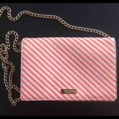 Kate spade pink and white ocean stripe Cute lightly used katespade bag. Pics for condition, pen mark inside and some rubbing on the back. Cheaper on bay and merc kate spade Bags Crossbody Bags