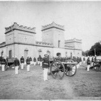 'Iolani Palace Barracks and Queen's Guard, Honolulu, O'ahu, 1892    Photo shows Queen Lili'uokalani's guard, which served during her reign from January 29, 1891, to January 17, 1893, in formation in front of the guard barracks.