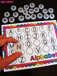 Alphabet letters bottle cap centers in a bunch of different levels for a ton of practice learning lowercase letters and uppercase letters with recycled caps!