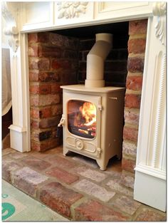 This is a beautiful white wood burning stove set in an inglenook fireplace. Wood Burner Fireplace, Inglenook Fireplace, Victorian Fireplace, Fireplace Hearth, Fireplace Inserts, Fireplace Design, Fireplace Ideas, Wood Mantle, Cream Fireplace