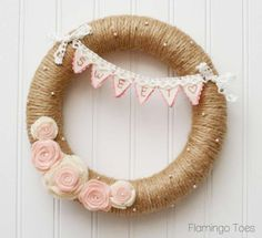 """I have such afun little Valentine's Wreath for you today! I don't always feel like using the traditional colors for holidays – but I guess I was in a romantic mood because this wreath is all pink and white and lace sweetness – and decorated with a little embroidered """"SweetHeart""""..."""