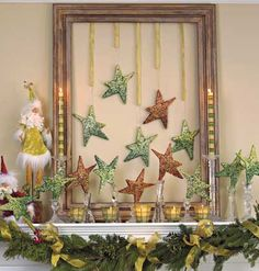 Southern Living - Mantlepiece decoration created by stringing ornaments w/ pieces of ribbon & securing to the top of a picture frame .