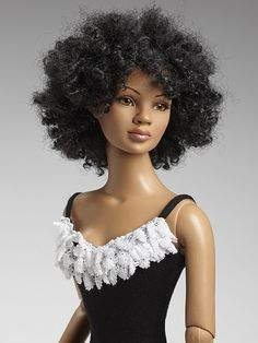 22″ American Model (African American) Basic doll by Tonner  [the doll comes w/2 wigs; the Afro wig shown, and a long straight wig. –MOD]