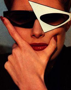 Helmut Newton for American Vogue, June 1983. Glasses by Alain Mikli.