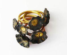 Tiny black poppy stacking ring by HenrietteWhite on Etsy https://www.etsy.com/listing/74147384/tiny-black-poppy-stacking-ring