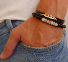 Men's Bracelet Set - Men's Beaded Bracelet - Men's Leather Bracelet - Men's Jewelry - Men's Gift - Boyfriend Gift - Husband Gift - Feather Bracelet  The simple and beautiful bracelet set combines 2 bracelet: 1 gemstone bracelet made of Onyx beads and Amazonite beads. The gem beads are strung together on a stretching silicone thread. 1 black leather bracelets with gold plated feather pendant. $37