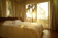 Playa Tranquilo Boutique Hotel on San Andrés Island, The Caribbean - Design by Ghada Dergham  Bedroom, sunset