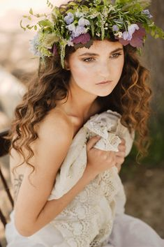 Free flowing hair and a wild flower garland make the perfect whimsical wedding look