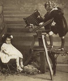 Edwardian POSTCARD: Cute Children + Antique CAMERA & Bicycle TOY, Christmas 1903 | eBay    Not a Civil War image, but an amazing picture. Love the camera, and look at the toy sitting on the camera stand! It's a bicyclist!
