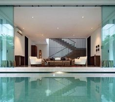 A chic and stylish living room décor is a great, meanwhile a pool inside a living room is greater. Find more ideas at https://www.divesanddollar.com/modern-living-room-with-pool/ #livingroompond #pond #homeimprovement
