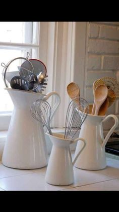 Store kitchen utensils in pitchers for a classy look