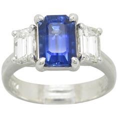 JB Star Blue Sapphire Diamond Platinum Ring  | From a unique collection of vintage three-stone rings at https://www.1stdibs.com/jewelry/rings/three-stone-rings/