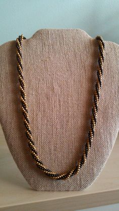 Check out this item in my Etsy shop https://www.etsy.com/listing/230347895/vintage-crown-trifari-gold-black-beaded
