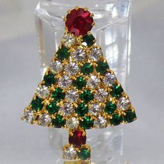 This #vintage rhinestone Christmas tree brooch is sparkly and gorgeous!  It features a gold tone tree filled entirely with clear and green sparkling rhinestones that are pro... #ecochic #etsy #jewelry #jewellery