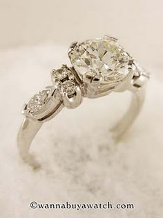 vintage diamonds, no halo style, size 7... Just in case anyone can pass that on  ;-) shhh! !