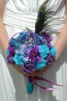 pretty turquoise and purple wedding boquet - minus the feather