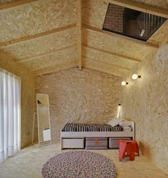 Gabled chipboard boxes connected by concrete stairs fill the open space of Casa Mac, a house designed by architecture studio La Errería in Alicante, Spain. Built In Desk, Built In Storage, Mac, Concrete Stairs, Concrete Stone, Mug Design, Micro Apartment, Timber Structure, Brick And Wood