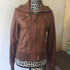 Urban Outfitters Faux Leather Moto Bomber Jacket Urban Outfitters Faux Leather Moto Bomber Jacket ---brand is sparkle and fade---size medium---wear on pocket zipper as shown---length is 22 inches and bust measures 19 inches---Runs small --- will fit a 4-6 and a small 8---very good used condition Urban Outfitters Jackets & Coats