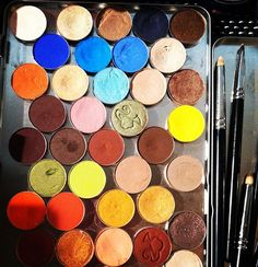 Lots of colorful MAC eyeshadows backstage at Victoria Beckham.  Photographed by Lauren Drago.