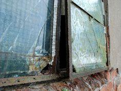 broken window and broken bricks