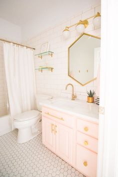 Modern Glam Blush Girls Bathroom Design gold hexagon mirror blush cabinets gold hardware white hexagon floor glass shelves pink bathroom cabinets gold orb Source by Pastel Bathroom, Gold Bathroom, Modern Bathroom, Small Bathroom, Bathroom Colors, Bathroom Sets, Feminine Bathroom, Bathroom Hacks, Ikea Bathroom
