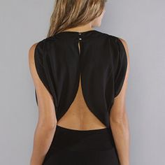 Simple black dress but I love the back