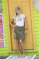 $32.00 Throw this adorable skirt on with a tank or a tee for a quick but stylish summer outfit! Elastic waist makes this an easy and comfortable fit. Looks great over swimsuits as well!  Olive Green Festival Skirt with blue pink and orange flower applique and teal stitching. 100% cotton and elastic waist.