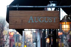 Rustic wall sconces provide a warm glow for diners seeking the European cuisine of the August restaurant. Restaurant Signage, Store Signage, Rustic Restaurant, Wayfinding Signage, Signage Design, Restaurant Design, Rustic Cafe, Rustic Cottage, Rustic Decor