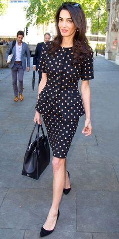 Mrs. Clooney headed to work in London sporting a chic polka dot suit that featured a peplum detail at the waist. As for her accessories, the brunette beauty opted for a few favorites: She toted her go-to Dior top-handle with matching black pumps and Prada sunglasses.