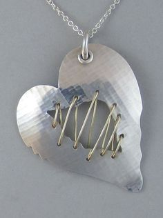 Sterling Stitched Broken Heart Pendant  $250.00