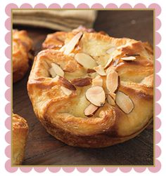 Almond Croissant Blossom | Flaky croissant dough topped with almond filling and toasted sliced almonds.