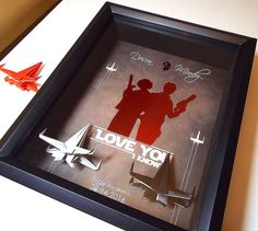 Personalized gift for Star Wars fanatics and geeks. This framed art was created by the seller and can only be found here. This listing can be customized to include the names of the couple and date of the event. Han Solo and Leia image printed in a shiny colored foil of your choice. Listing also includes two Star Wars origami X Wing figures making this our most unique anniversary and Valentines Day gift for couples.  This is a perfect Valentines Day or Anniversary gift for boyfriend…